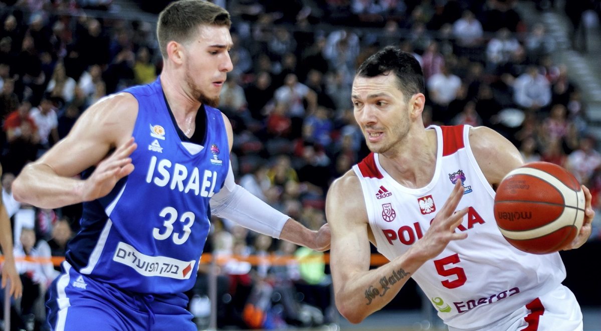 Polands Aaron Cel (right) in action against Israel