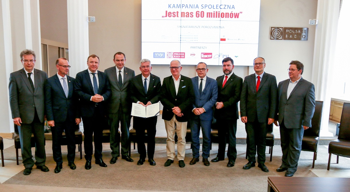 "The signatories behind the ""We Are 60 Million"" drive; Polish Radio CEO Andrzej Rogoyski fourth from right. Photo: Robert Bartosewicz/Polish Radio"