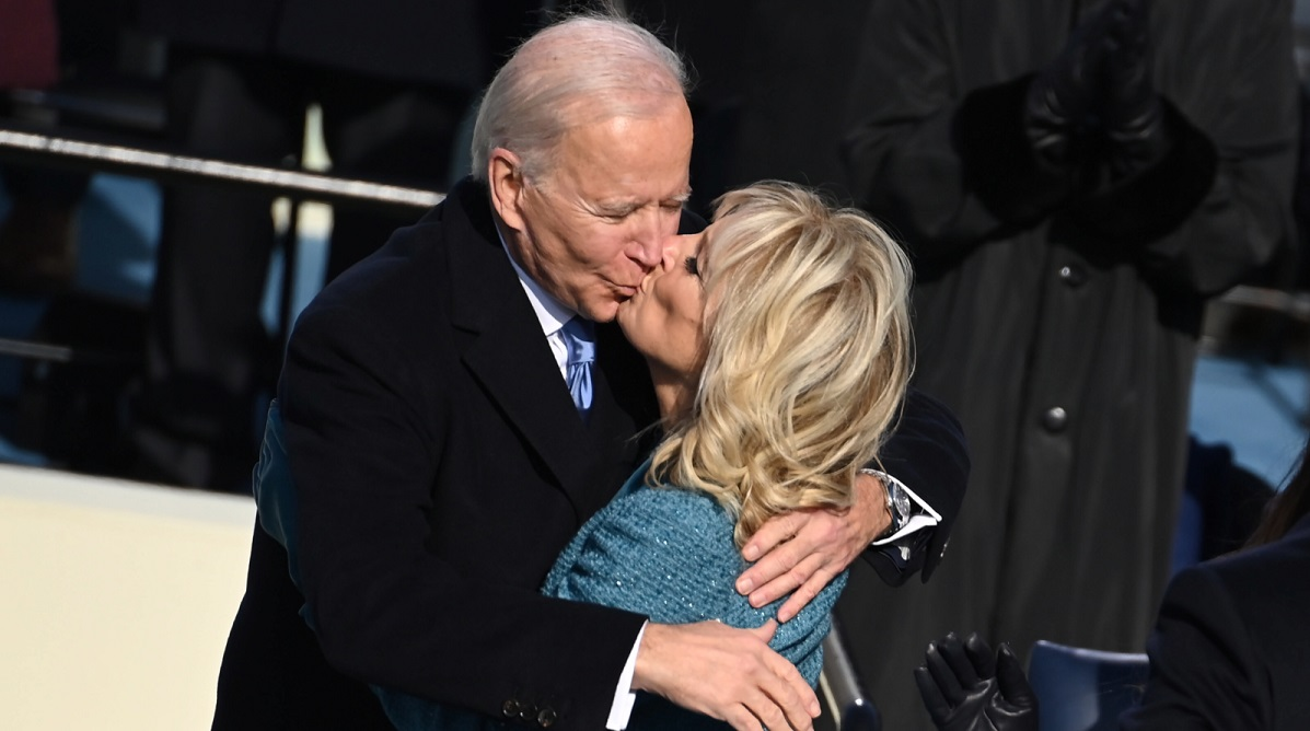 US President Joe Biden kisses incoming First Lady Jill Biden after being sworn in on Wednesday. Photo: EPA/SAUL LOEB