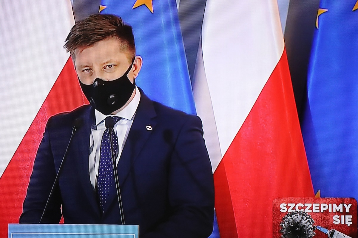 Michał Dworczyk, the man in charge of Poland's COVID-19 vaccination campaign; seen on a screen during a virtual media briefing on Wednesday.