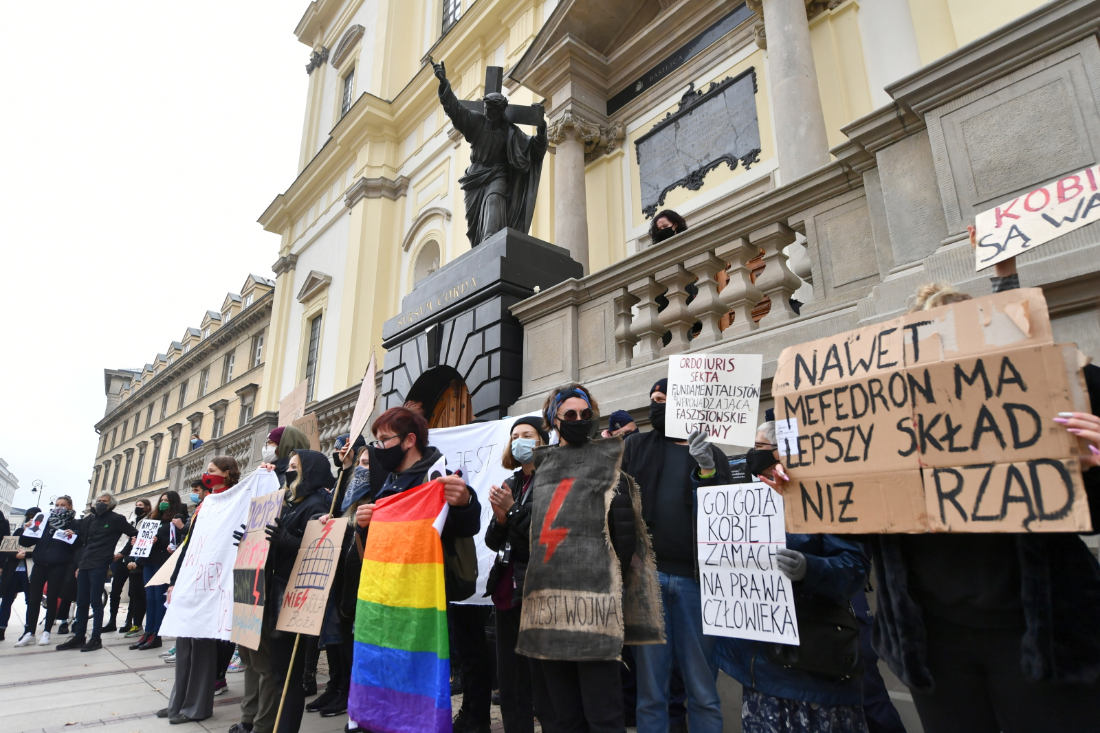 Protesters gathered in front of the Church of the Holy Cross, close to Warsaws Old Town, on Sunday, October 25.
