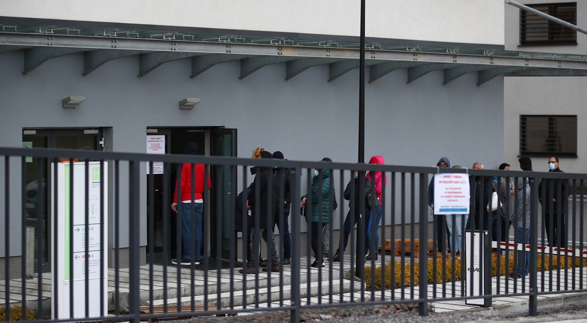 People line up to be tested for coronavirus at a hospital in the southern Polish city of Kraków on Wednesday, Oct. 14, 2020.