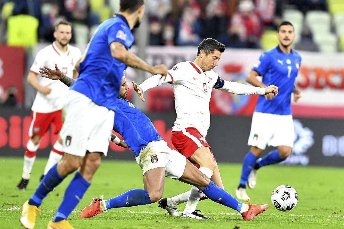 Poland captain Robert Lewandowski (second from right) in action against Italy on Sunday night.