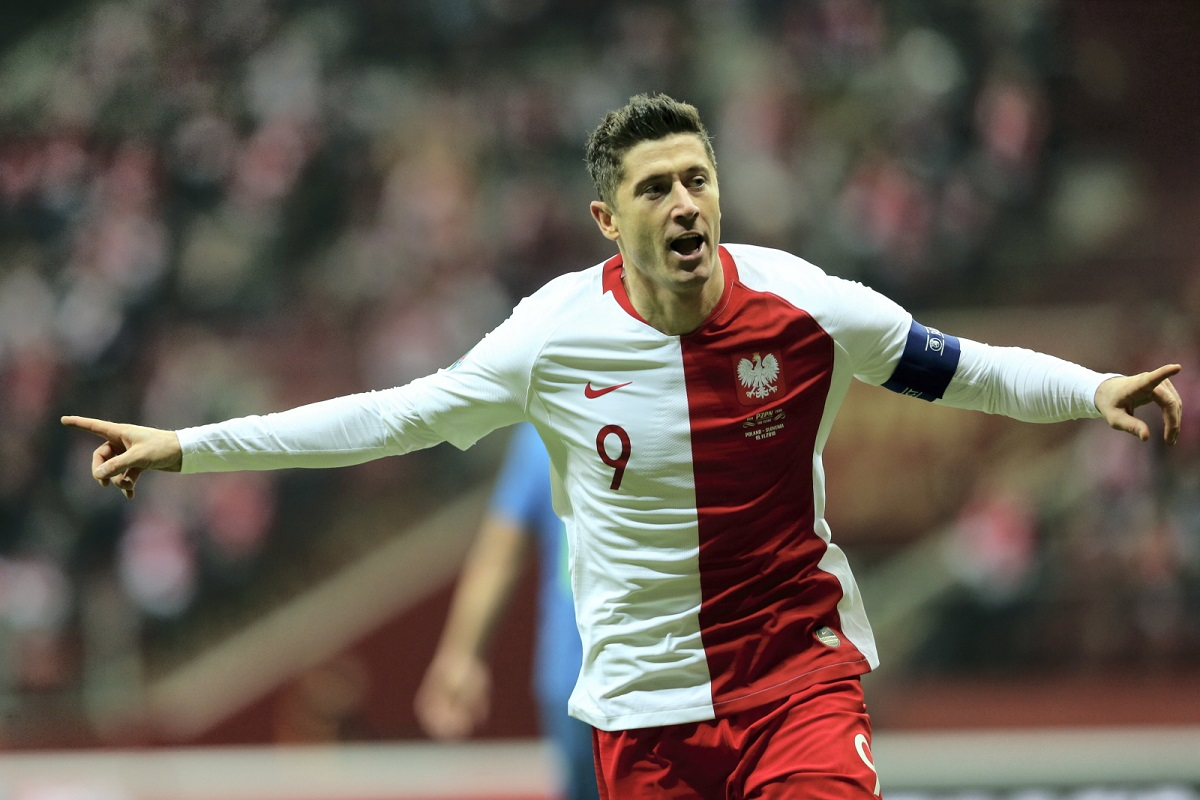 Star striker Robert Lewandowski celebrates after scoring the 2-1 lead for Poland against Slovenia at the National Stadium in Warsaw on Tuesday night.