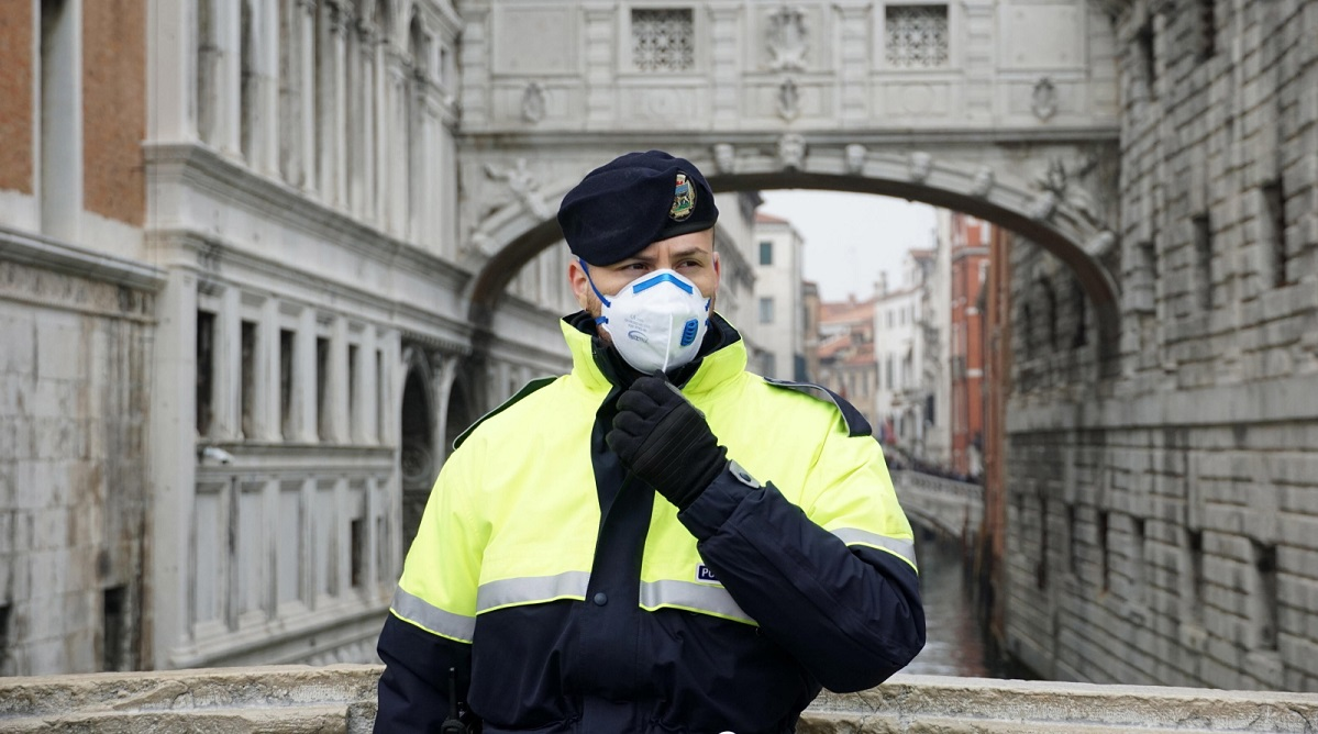 A police officer wears a protective face mask during the Venice Carnival in Italy on Sunday. The last days of the carnival were cancelled.