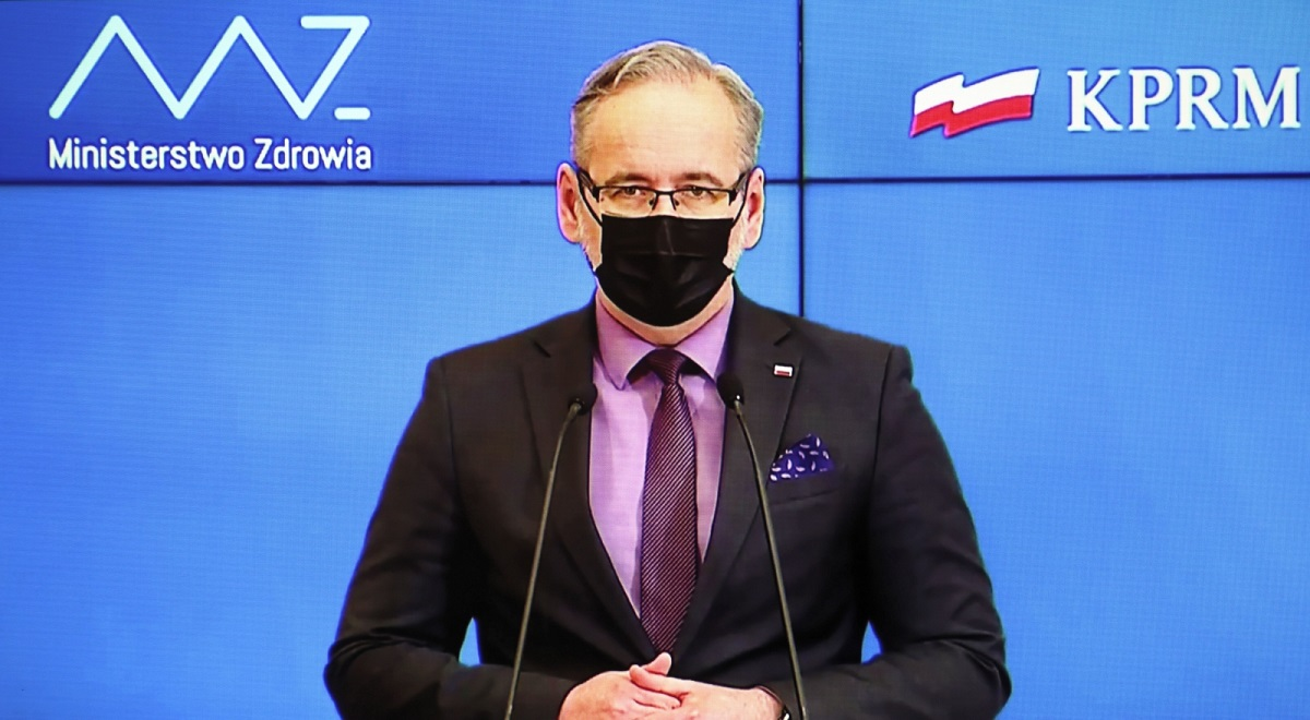 Polish Health Minister Adam Niedzielski is seen on a screen as he holds a virtual news conference on Wednesday.