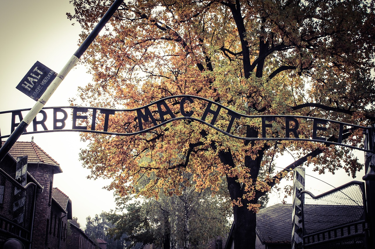 Entrance to the former Auschwitz death camp with the infamous Arbeit Macht Frei (Work sets you free) sign.