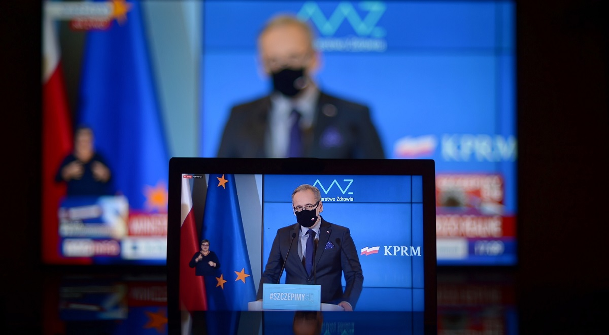 Polish Health Minister Adam Niedzielski is seen on a screen as he holds a virtual news conference on Monday, Jan. 11, 2021.